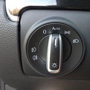 OEM auto headlight switch.